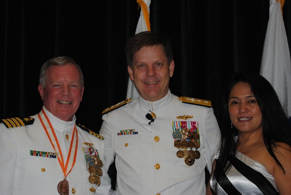 Rear Adm. David Simpson, USN (l), congratulates Capt. Gerry Slevin, USN, chapter president, who is joined by his wife Ruby, at the captain's retirement ceremony held at MacDill Air Force Base in Tampa, Florida, in June.